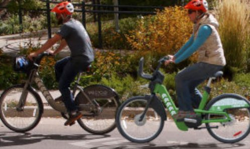 A WE-cycle e-biker and cyclist
