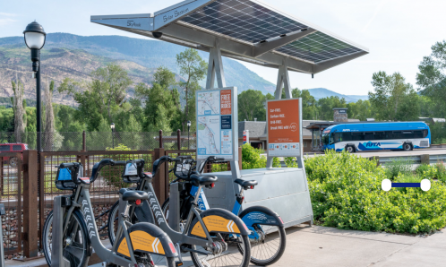 WE-cycle station with RFTA bus in the background